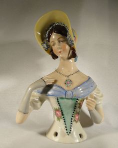 Antique big William Goebel half doll with yellow hat/necklace