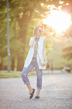 1darya kamalova from thecablook com in milan for fuori salone 2014 wearing sleveless white vest jacket with boyfriend ripped jeans and gucci disco boho bag-3
