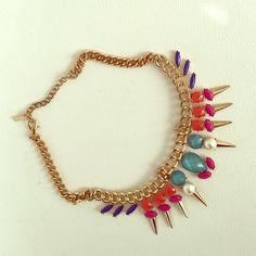 edgy statement necklace Never worn, originally purchased from the brand Mika. An awesome piece that has bright, fun colors and pearls combined with gold spikes! Adjustable length. Jewelry Necklaces