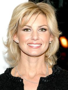 With wispy side bangs, Faith Hill shows off a delicate wave through her shaggy bob.