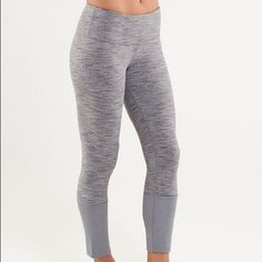 Lululemon Gray Wunder Under w long cuff at bottom Special edition! In great condition. They fit like the typical WU but the long cotton cuff at the bottom makes it about 7/8 length, and it can be worn long or rolled up. There's also a cute little secret pocket on the left cuff. lululemon athletica Pants Leggings