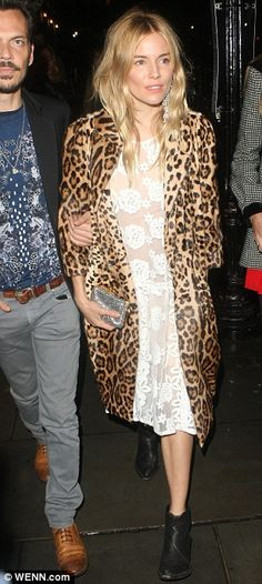 Sienna Miller.. in a Borne by Elise Berger dress and a Dolce & Gabbana leopard-print coat... Vogue dinner at Balthazar.. LFW..