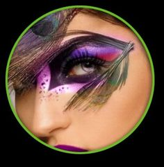Cool makeup, but I bet the peacock feather on the side of the eye would drive me absolutely bonkers, and then my eye would tear, ruining the whole effect, and making a magenta runny mess. Oh well. a girl can dream, right?