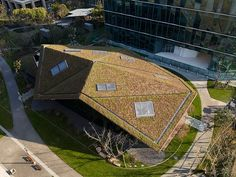 the low-rise building for multi-use features an oversized roof reminiscent of japanese origami techniques.