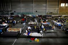 CONKLIN/LAC LA BICHE, May 6 (Reuters) – Fort McFurray residents take shelter at the Bold Center in Lac la Biche on May 5. Evacuees from the Fort McMurray wildfires use a hockey rink full off beds as they sleep and rest ... - Mark Blinch/REUTERS