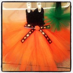 18 M - 2T  Tulle Pumpkin Tutu  Dress  over 100 Yards of  festive tulle. Matching Crochet Headband. $35.90, via Etsy.