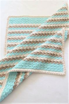 This free crochet blanket pattern is perfect for beginners. The border does not use any post stitches. This afghan can be adapted for a boy or a girl. The pattern easy, simple, and fast. #freecrochetblanketpattern, #easycrochetblanketpattern, #freecrochetbabyblanket Easy Crochet, Crochet Hooks, Free Crochet, Graph Crochet, Crochet Stitches Patterns, Baby Patterns, Sweater Patterns, Square Patterns, Baby Blanket Crochet