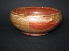 Boyka Pottery, Bowl. Shino glaze. High fire reduction with gas. This firing is usually done at C9-10 - 2350°F. It continues for about 2 days and afterward  kiln cooling takes as long as the firing continous.