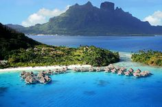 Bora Bora Nui Resort Tahiti is a island with bungalow's over water and huts going all the way up a tall mountain. Paradise in every way you could think of.