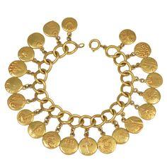 """Les Arrondissements de ParisFrance  ca. 1945-1950  """"The Arrondissements of Paris""""  A bronze doré bracelet    The pendants which dangle from each link of the bracelet symbolize the """"arrondissements"""", or districts of Paris."""