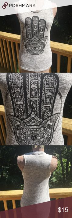 Fifth Sun Graphic Grey Hamsa Tank Top Good used condition graphic tank top. It has a vintage looking Hamsa on the front. This material is heavier. It has signs of washing, a bit of piling and bit of fuzziness. But it still has plenty of wear left.  Sized small. 55% rayon 45% polyester.  Measurements Laid flat: armpit to armpit about 14 3/4 inches,  armpit to hem about 15 1/2 inches. Fifth Sun Tops Tank Tops