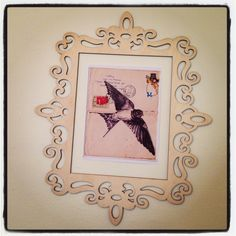 DIY wall art on the cheap - $7 laser cut balsa frame from michael's + printed out copy of one of Mark Powell's beautiful bird drawings on vintage envelopes + 2 squares of residue free removable scotch wall stickies. Voila.