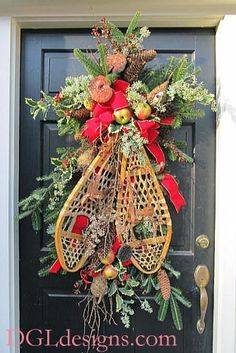decorating snowshoes for christmas photos | Atlanta Christmas door wreath using clients snowshoes cones berries ...