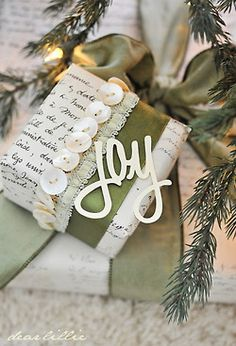 Joy ornament, script wrapping paper, mother of pearl button and ribbon trimmed gift