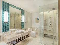 Deluxe Guest Bathroom  Experience luxury when staying at the Renaissance Phuket Resort & Spa. Our elegantly styled guest bathrooms offer amenities such as a separate walk-in shower and oversized tub.