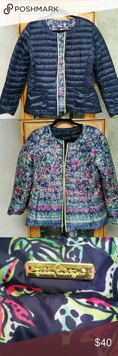 Lily Pultizer reversible 'puffer' jacket Stunning never worn reversible Lily jacket. There isn't a size tag on it but it's a large. It runs small so it fits like a medium. One side is a Navy and the other side is a multi color. It's absolutely beautiful.  I am downsizing my closet. Lily Pultizer  Jackets & Coats