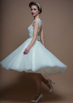 White dress and petticoat swept out.