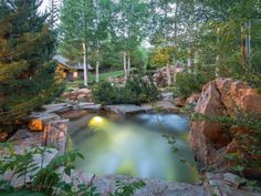 Beautiful setting and stone work surrounding this swimming pool in this fantastic Idaho home.