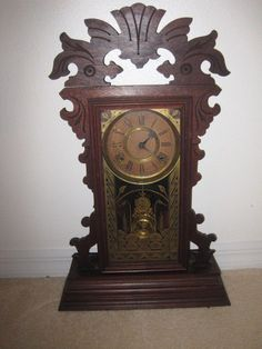 Ansonia Gingerbread Clock with key and pendulum
