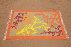 obsessed with this coral rug, made in Malawi
