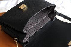 The Louis Vuitton Pochette Metis in black monogram empreinte leather with gold hardware - review and overview - luxury fashion blogger UK