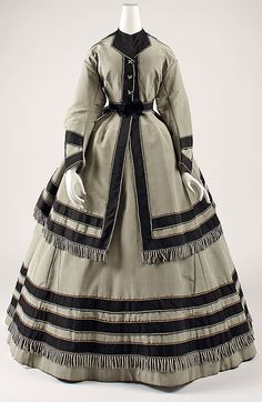 Grey and black silk wedding dress (front), American, 1866-69. Worn with matching grey silk side-laced boots.