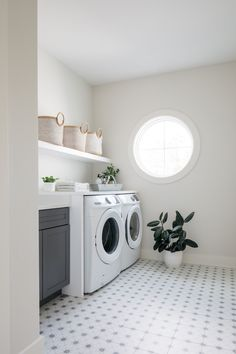 Laundry Room Besides featuring a beautiful round window, this upper-level Laundry Room also features dark grey cabinets, a custom wall-to-wall floating shelf and patterned porcelain tiles #laundryroom #greycabinet #upperlevellaundryroom #upperlaundryroom #roundwindow #patternedtile Laundry Room Inspiration, Interior Inspiration, Laundry Room Design, Laundry Rooms, Farmhouse Ideas, Modern Farmhouse, Benjamin Moore Silver Satin, Sherwin Williams White, Rustic Staircase