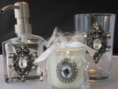 Great deal on fabulous Lux Brand vanity set with silver crest embellishments.  All three pieces - lotion/soap dispenser, tumbler, and Italian Linen scented votive for just $40