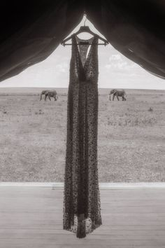 A beautiful photograph of a wedding dress from a destination wedding in Kenya. #TOMSWedding