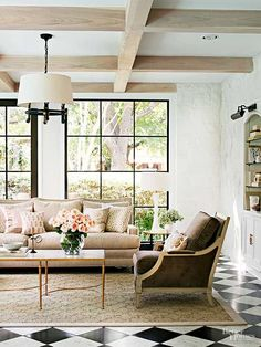 """Patterned floors:""""intersecting squares set at an angle provide a neutral contrast to the warm beige and cocoa hues in the fabrics."""""""