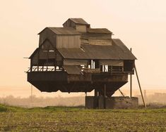 Floating castle in the Ukraine. Supported by a single cantilever, this mysterious levitating farm house belongs in a sci-fi flick. It's rumoured to be an old bunker for the overload of mineral fertilizers...