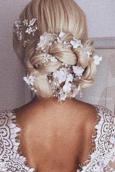 wedding hairstyle from ulyana aster braided updo with white flowers ulyana aster