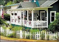 Patriotic Cottage With Picket Fence.