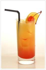 Peachy Screw  1-1/2 ounce Absolut Vodka  1 ounce Malibu Coconut Rum  1 ounce Peach Schnapps Liqueur  2 ounces orange juice  2 ounces Sweet and Sour mix  1/2 ounce grenadine