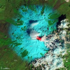 Sicily's Mount Etna is seen erupting in this false-colour image taken with the Advanced Land Imager on NASA's Earth satellite. Fresh lava, erupted hours earlier, is seen as bright red. Etna Eruption, Etna Volcano, Satellite Photos Of Earth, Earth Photos, Pyroclastic Flow, Fuerza Natural, Spiegel Online, Earth From Space, Natural Phenomena