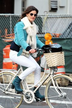 Hanneli Mustaparta proves you can peddle through the city in sturdy heels.   - HarpersBAZAAR.com