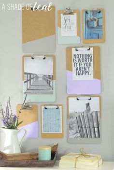 Clipboard gallery wall by a shade of teal. Such a creative and pretty idea that can work with the simplest clipboards.