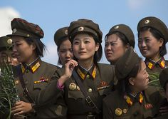 Smiling North Korean Female Soldiers In Tower Of The Juche Idea, Pyongyang, North Korea 20130609