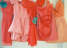 Mismatch bridesmaid's dresses in shades of pink and coral. LOVE THIS IDEA!!!