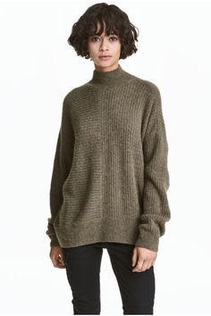 Ribbed jumper: Loose-fitting jumper in a soft rib knit containing some alpaca wool with a turtle neck and low dropped shoulders.