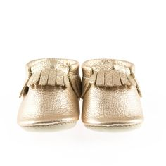 Platinum fringed shoes with a quirky name and a more muted shine than our other metallics. Narwhal is an in-between gold and silver colour. Baby Booties, Baby Shoes, Designer Kids Clothes, Comfy Shoes, Toddler Fashion, Sale Items, Moccasins, Lady, Baby Style
