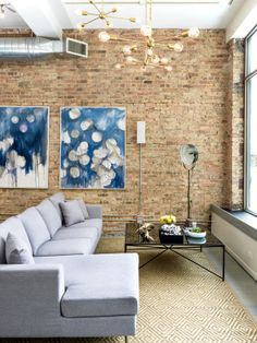 From our original Chicago Guideshop location: the Asher sofa, artwork by Linc Thelen, Jax coffee table & Spark Lights by Grey Furniture. | Showroom design by Brynn Olson Design Group. | Photo credit: Cynthia Lynn Photography