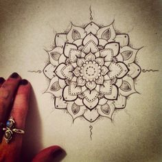 love this - its pretty and has the dot work I like incorporated Also like the flower shaped center