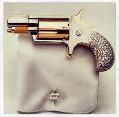 I want. And need. Bedazzled revolver.