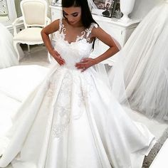 This illusion neckline bridal gown has beautiful embroidery and lace detail. Brides searching for unique & couture looking #weddingdresses will find our company can help with our services. In addition to custom wedding gowns we also make inexpensive #replicaweddingdresses that look like the original but are not as expensive. We can give pricing on any dress you love from the internet at www.dariuscordell.com