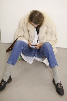 Jeans with socks & loafers plus furry coat.