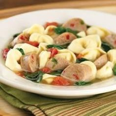 """""""Italian chicken sausage is simmered with wine, broth, tomatoes, spinach and tortellini for this hearty, Italian-inspired favorite."""""""