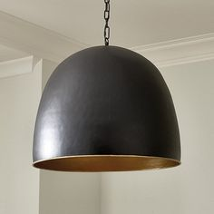 Drama on a grand scale. Our stunning Kent 1-Light Pendant is hand crafted of matte black iron with golden interior to create a dome of warm light over a family sitting group, gaming table or cozy dining area. Kent Dome Pendant features:Hand hammeredChunky decorative hanging chain