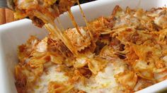 Bow-tie pasta and beefy pasta sauce is mixed with mozzarella cheese ...