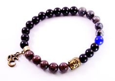 Hand crafted in a balanced environment, this jewelry is made from high quality natural elements.   Materials: -8mm black onyx beads -8mm Jasper Beads